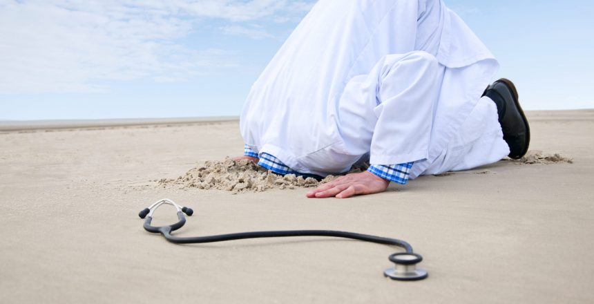 Doctor hiding head in sand. In the front a stethoscope.have a look at different variations: